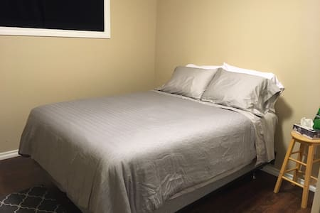Queen bed - private room- located in a new home.
