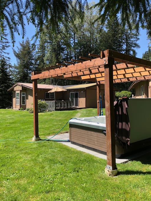 Make great memories relax and enjoy the new hot tub at the spacious Bears Den . A premium home with the bbq deck and picnic ready grounds .