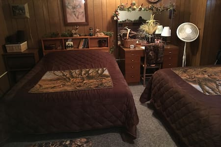#1 Brown Hunting Room:  2 Queen Beds, Writing Desk, Dresser Top