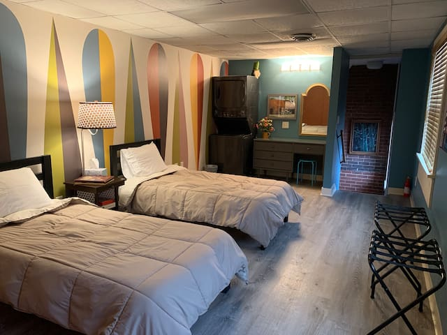 The 2nd bedroom was renovated in November 2019 with a retro mural wallpaper, new flooring, washer/dryer and a cozy feel.