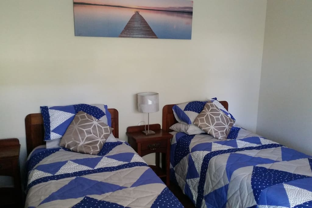 Two King single beds in a spacious, air conditioned, private room.