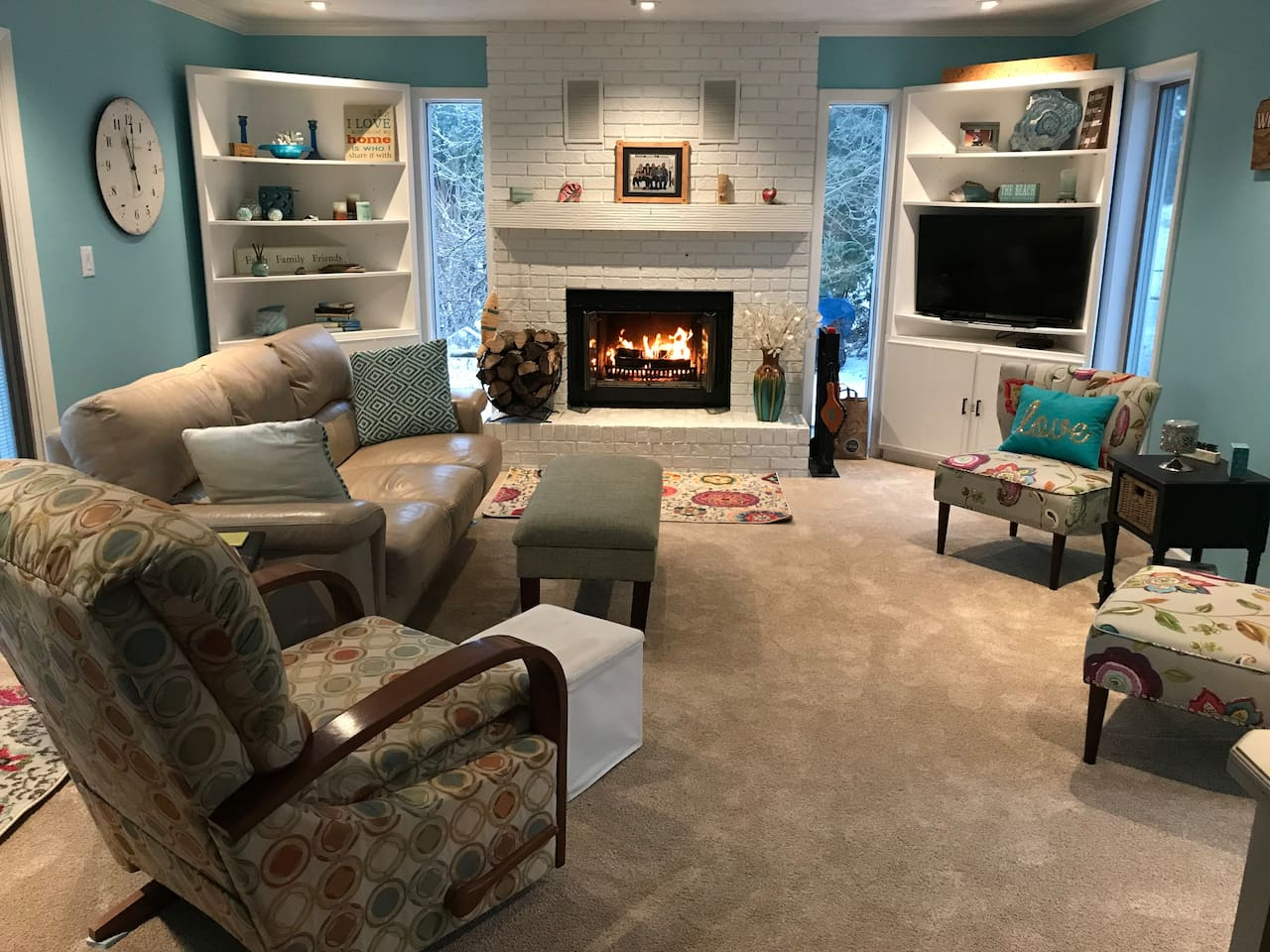 Can't you just picture yourself relaxing here? This cozy living room is shared by all guests and includes cable TV, fireplace and easy access to the deck/yard for the warmer months.