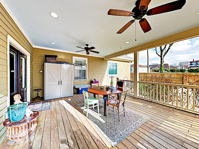 The covered back porch has a 4-person dining table for alfresco meals.
