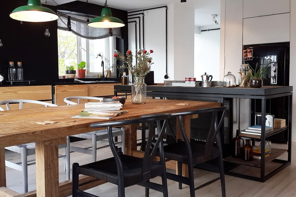 the open plan kitchen is perfect for dinners with friends and family