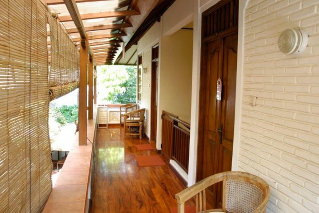 Balcony with gorgeous hardwood flooring.