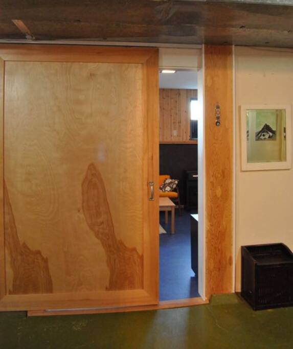 Custom sliding door -- a beautiful entrance to your massive room!