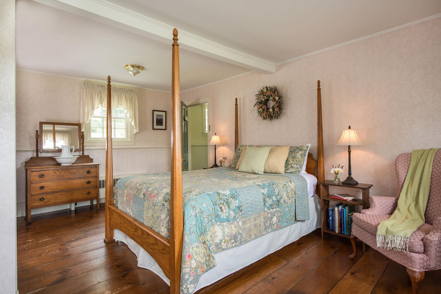 With a queen size bed, sitting area and views of Mt. Mansfield.