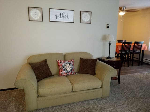 "Comfy loveseat, perfect spot to ""gather."""