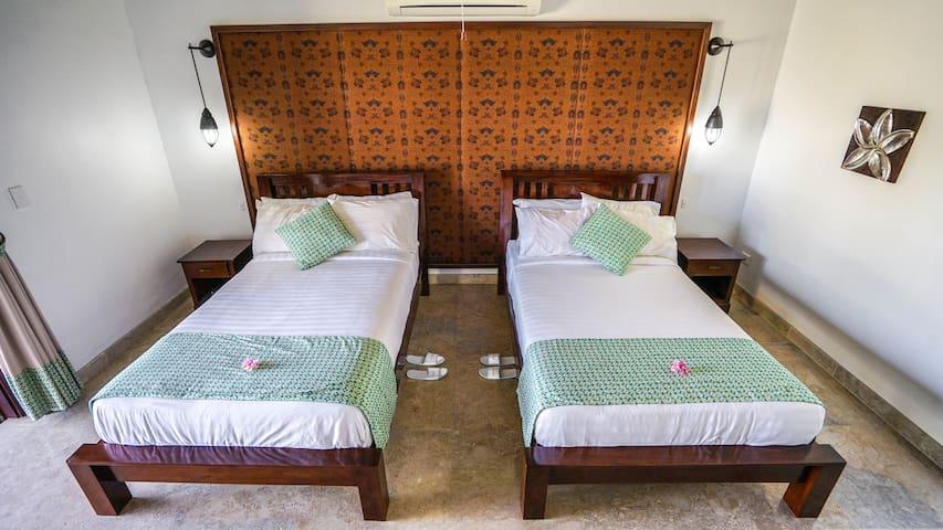 Deluxe room at Nembralanow! Beachfront Villa