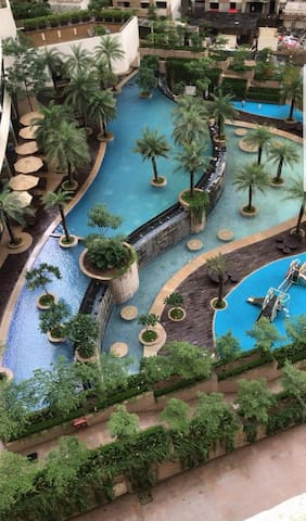 Clubhouse with 2 large pools. Can be used by guests at Rs 100/visit