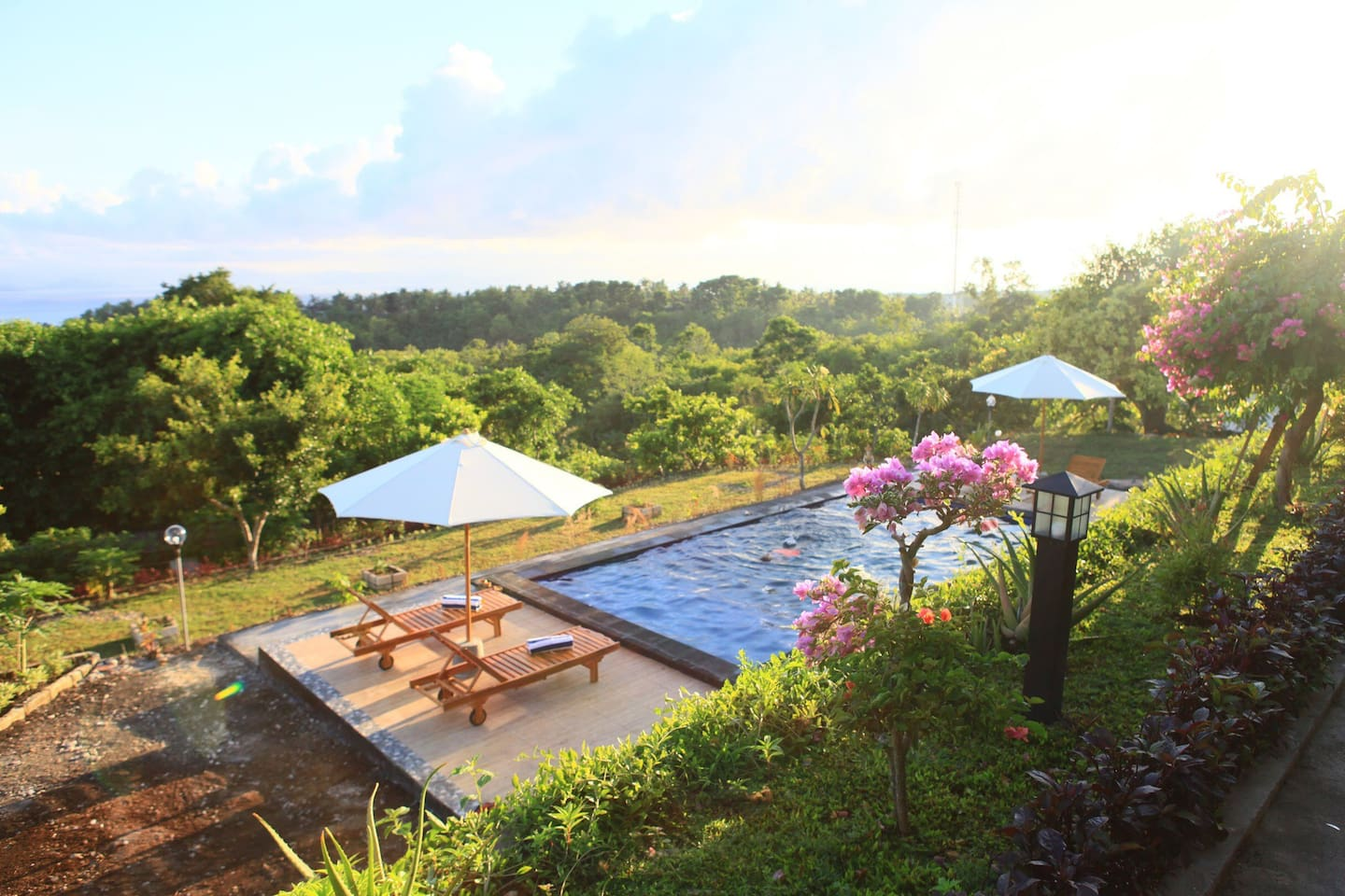 Teba Garden Hill set on the hillside with magnificent view of distance ocean view, mountainous, and green forest of Nusa Penida Island.