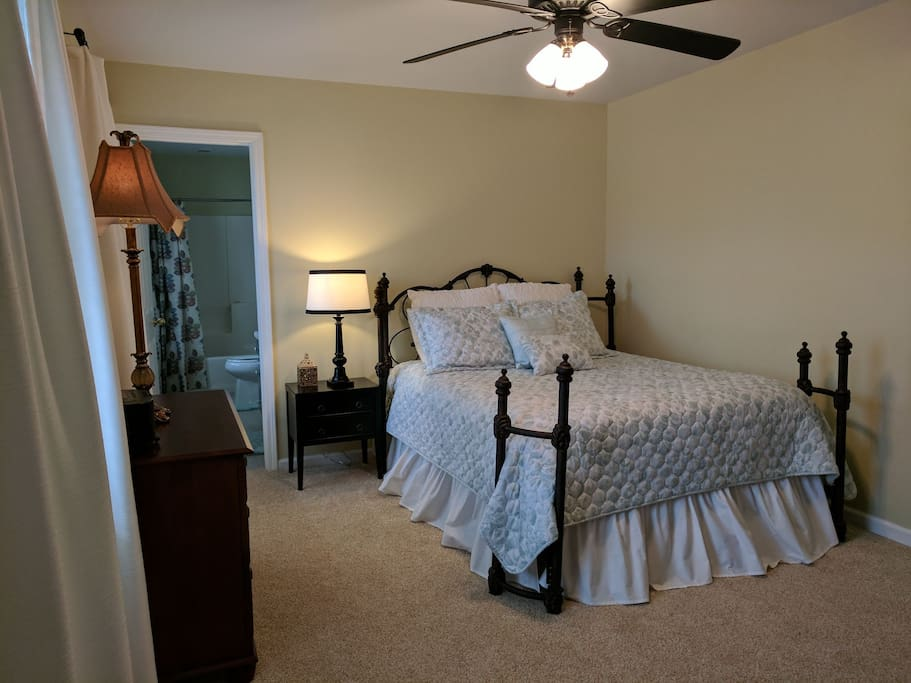 Private bedroom with queen size mattress and ceiling fan.