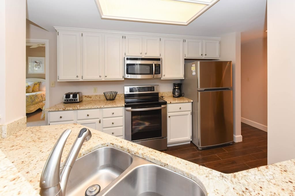 Kitchen with granite and stainless