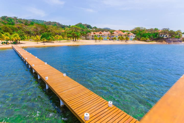 view from sunset pier and snorkel dock toward the Lawson Beach Club complex
