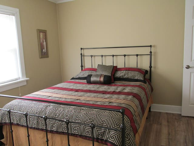 Front bedroom; modern feel with queen bed and fresh linens.