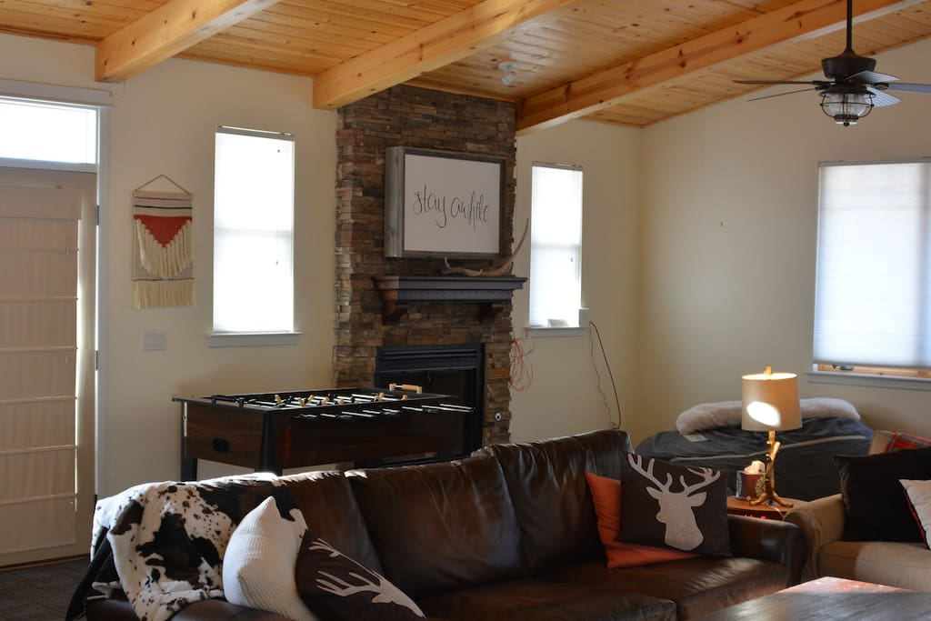 Great room features smart TV, Big Chill fridge, love sac, and plenty of comfy seating