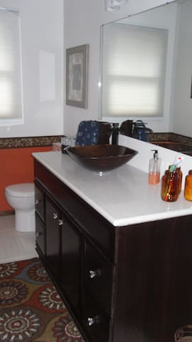 Full bathroom with tub/shower, also 1/2 bath in home for use.
