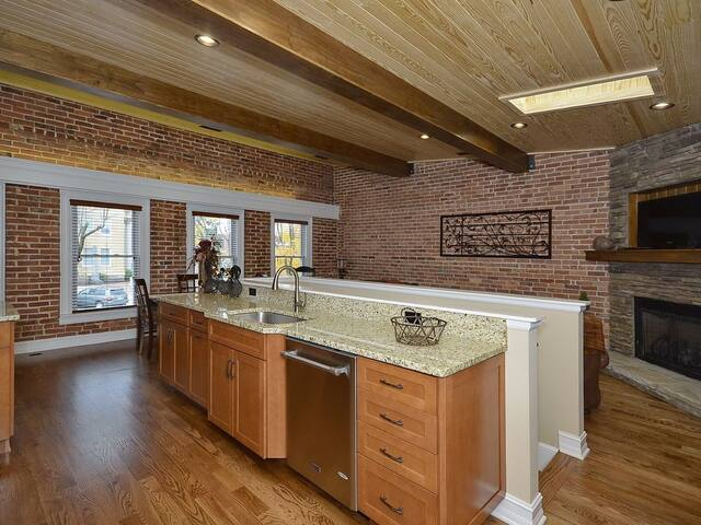 Charming exposed beams, tongue and groove ceilings and exposed mason brickwork