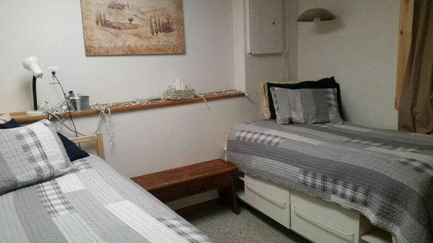 2 singles bedroom with private bath/familyroom
