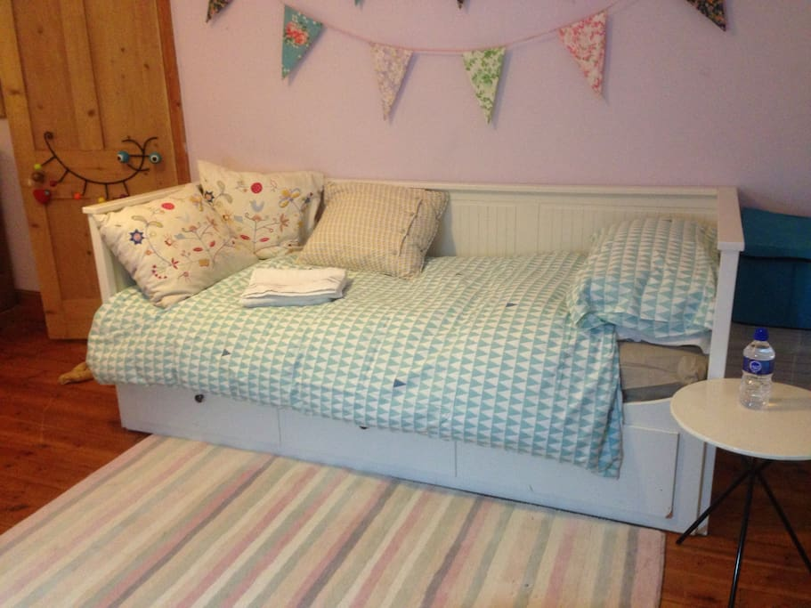In addition to the double bed there is a very comfortable day bed in the room. This be used as a single bed or it can be opened out to a double.