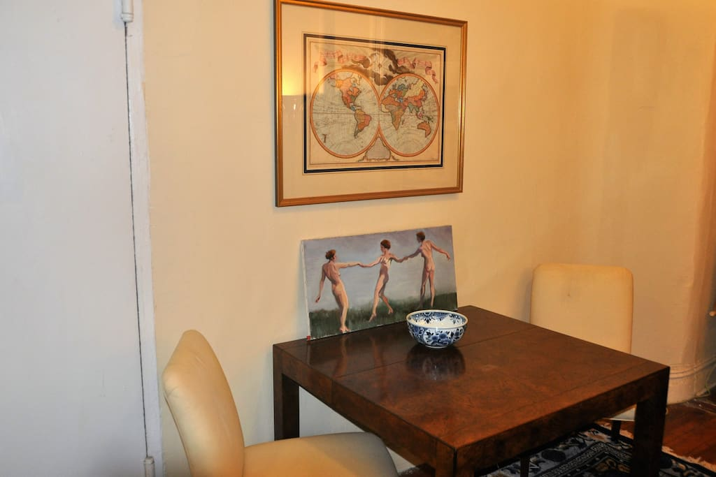Dining table with antique map.