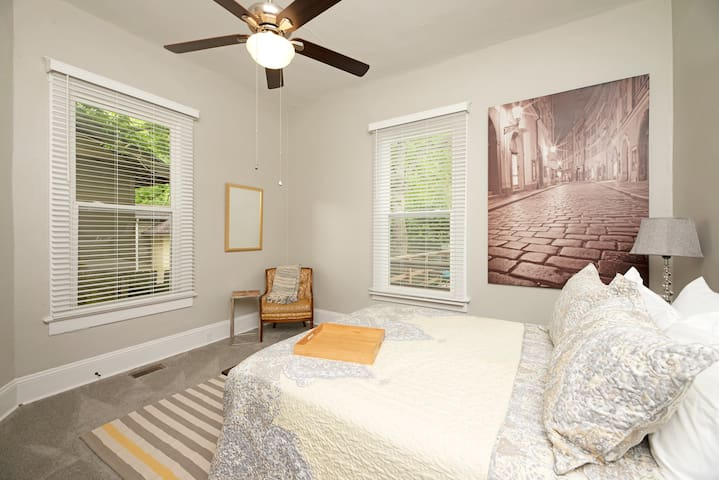 Spacious 2nd bedroom with ceiling fan and large armoire for unpacking.  Each bedroom has its own USB charger on the nightstand.