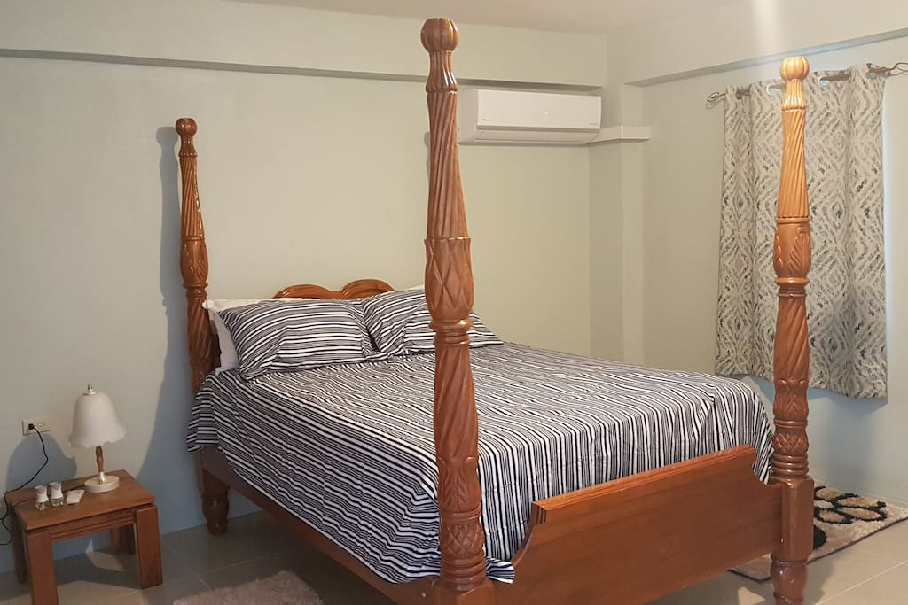 Queen sized bed with fully air conditioned room