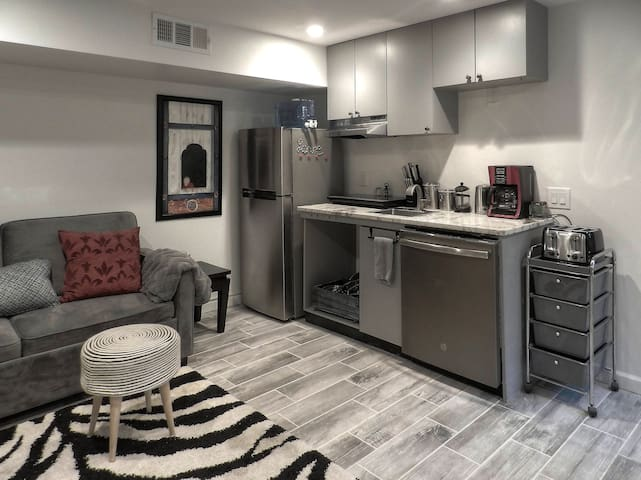 Sofa sleeper for friends that like to sleep in separate rooms.   Efficient kitchen with new refrigerator and dishwasher.  Hot water