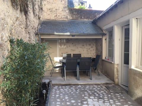 Maison avec jardin dans quartier historique