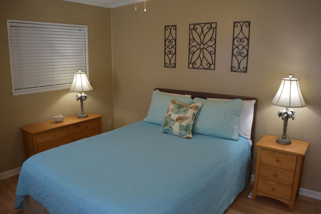 The bedroom is equipped with a comfortable Queen bed & lots of storage!