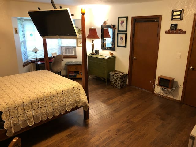 Spacious Master with suspended TV, electric fireplace, private bathroom, and bunkhouse.