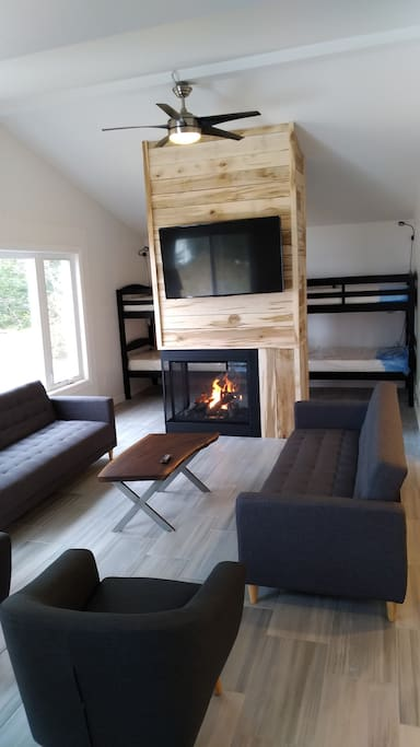 Living room and bunk beds behind the fire place