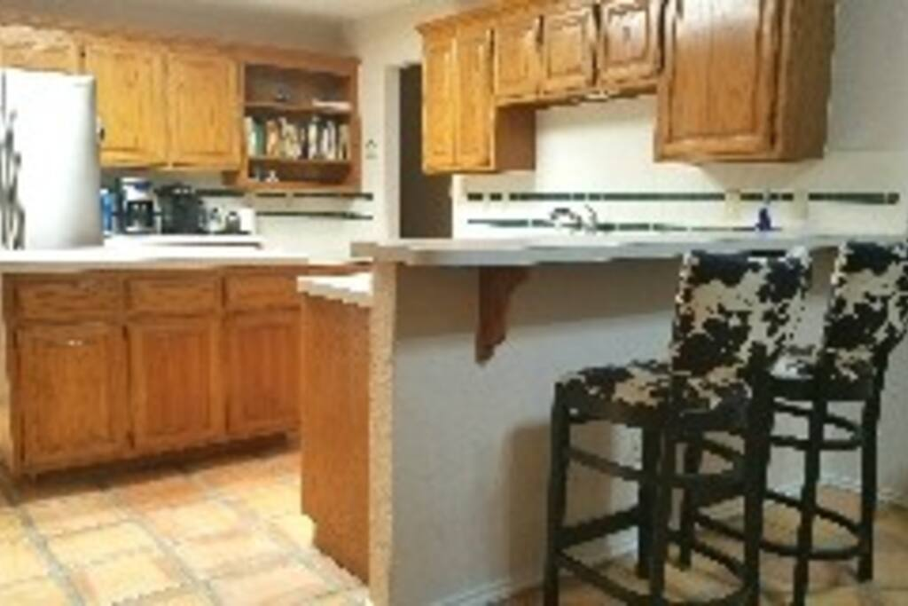 Fully equipped shared kitchen area.