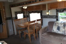 Quaint dining area. Doesn't feel like a cookie cutter RV kitchen/dining area. The chairs move!