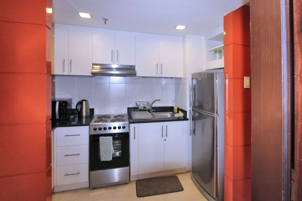 A fully equipped kitchen with all necessary appliances, cookware and utensils, .....