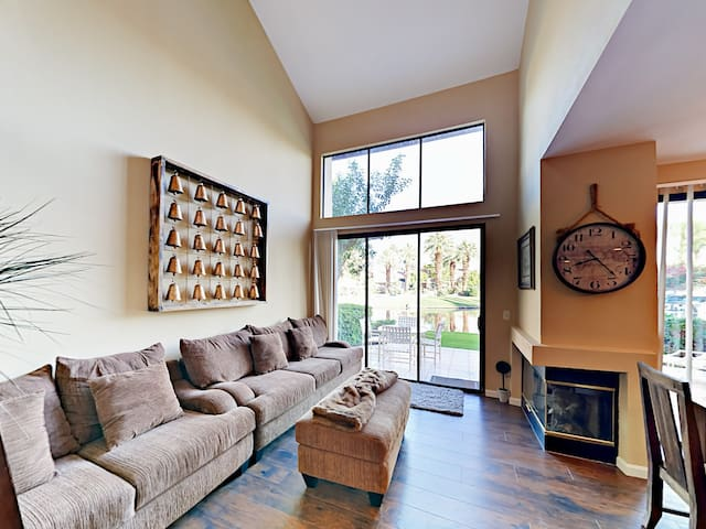 Stretch out next to the fireplace on a sofa and matching love seat in the family room.