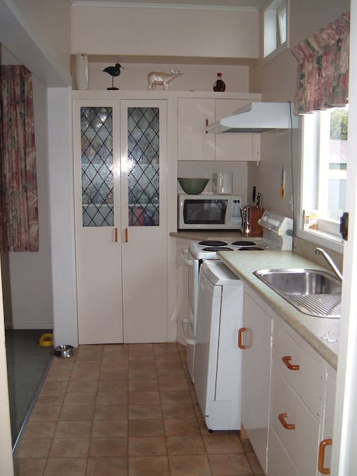 Small kitchen, but has all the things we need like a dishwasher, microwave and oven!