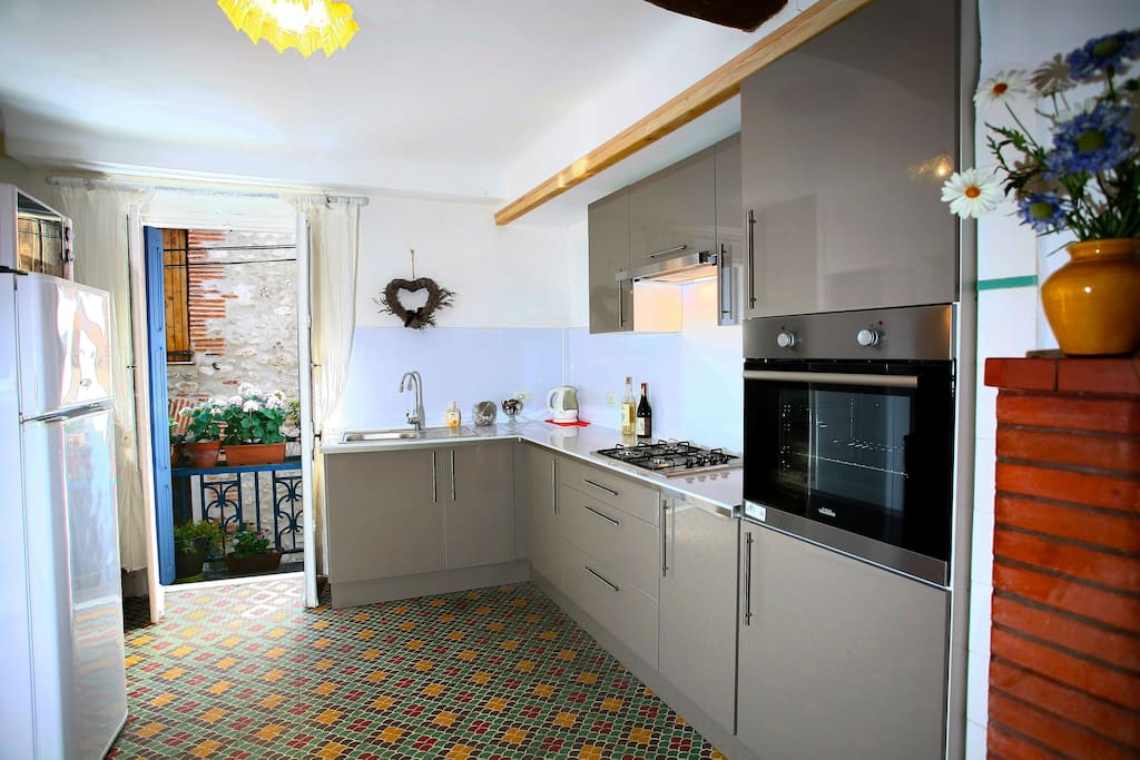 A new modern kitchen, and lovely balcony