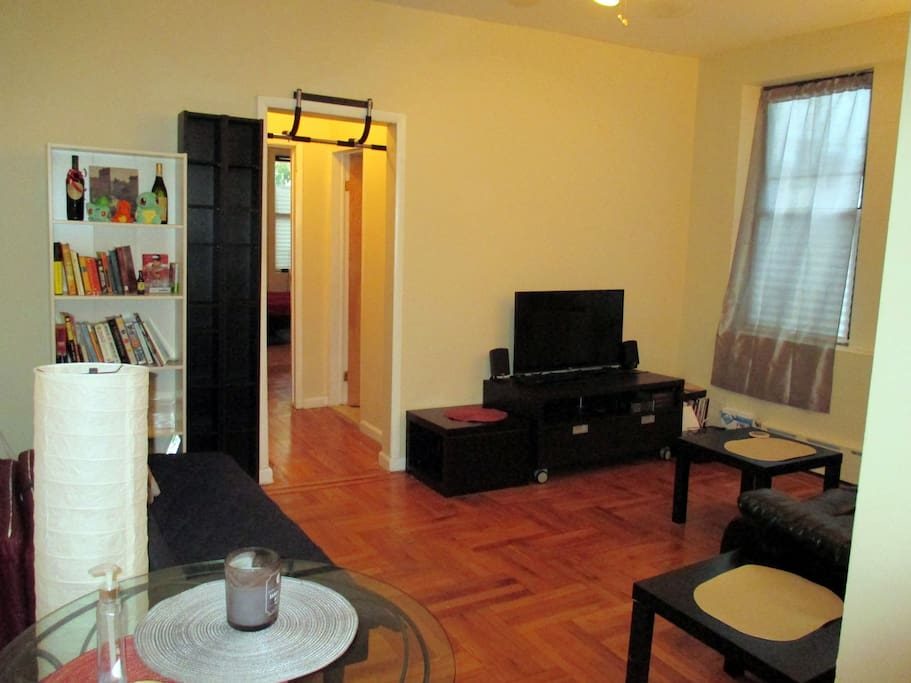 Spacious and comfortable living room with TV, walk-in closet, reclining leather couch (sleeps 1), futon (sleeps 1), music speakers.