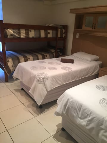 One of the rooms has two single beds which can also be converted to a king bed with a bunk bed with two single beds