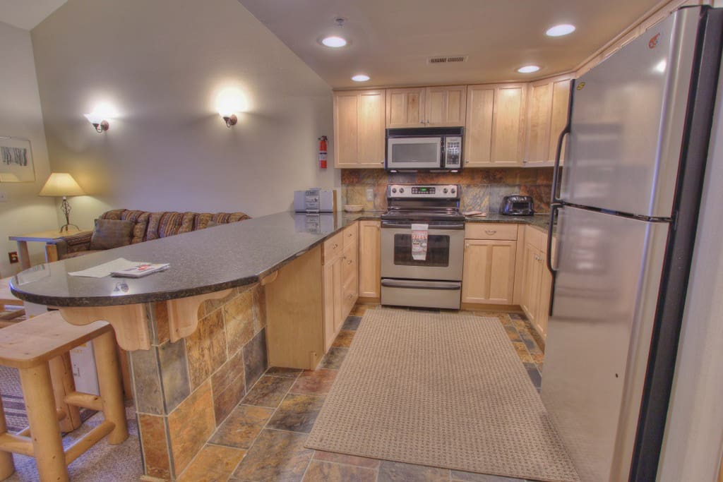 Fully Equipped Kitchen with Stainless Steel Appliances, Bar Seating for 4