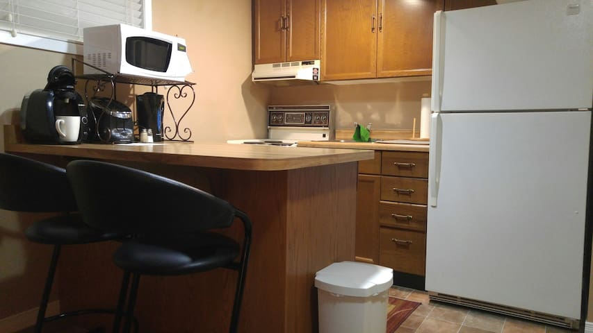 Kitchenette with all the appliances, cookware, dishes etc  you need