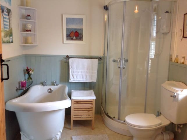 Private bathroom with roll-top bath and separate shower