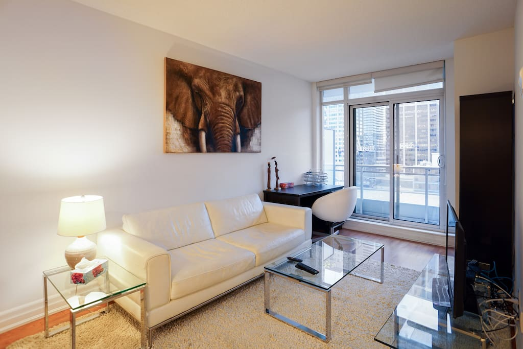 """""""This apartment is modern and chic. It has everything you could need, it is extremely clean, the beds are comfortable (both are real beds - no futon or air mattresses), and the balcony offers lovely urban views of the city skyline. Our host was very gracious and rented us her space when we booked quite last minute. Everything went very smoothly!"""" - Erika"""