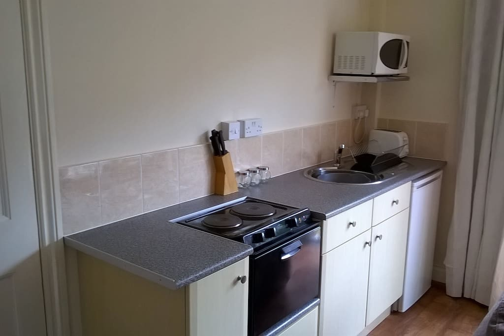 Compact kitchenette with Baby Belling cooker and fridge