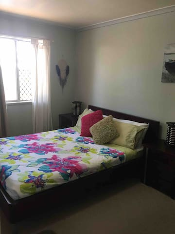Comfortable Queen bed with bedside tables, large desk & chair