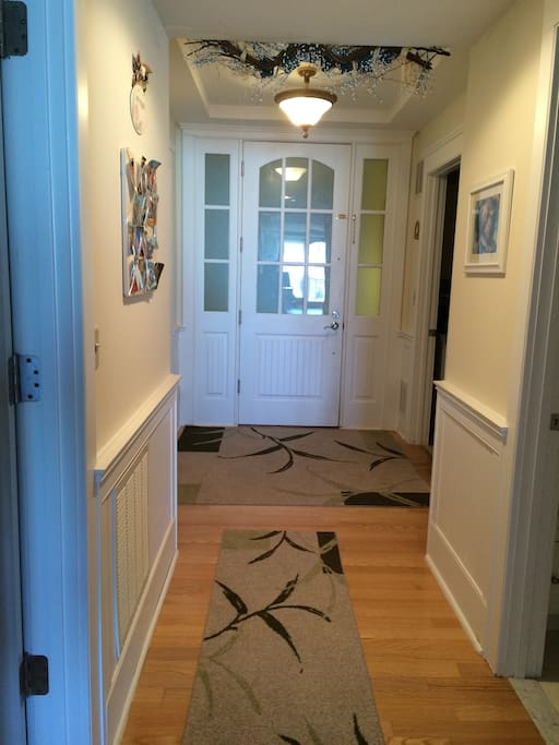 Warm Welcoming Entrance Hallway w/ Laundry Room to Left & Kids Bedroom to Right