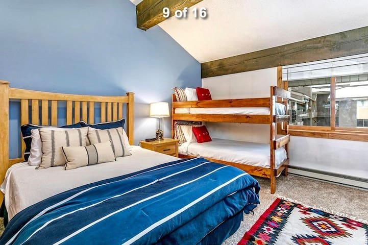 Large room with queen bed and a bunk bed.  Full closet and set of drawers to keep your clothing.  Also includes TV in the room.