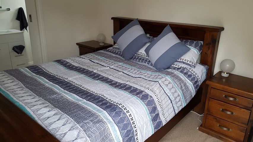 Queen size pillow top bed, electric blanket for the winter, split system aorcon for the summer.