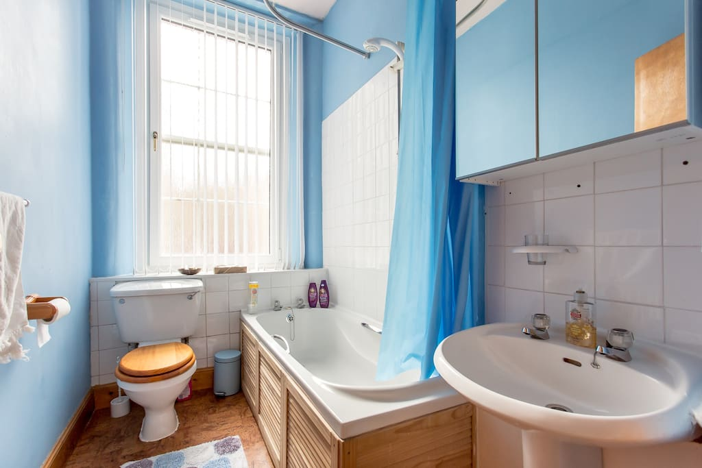 A bright sunny bathroom with electric shower.
